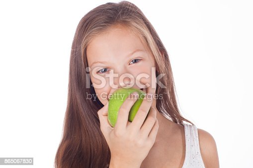 104545719istockphoto Beautiful young girl with green apple. 865067830