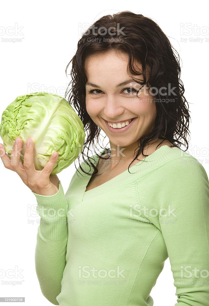 Beautiful young girl with green cabbage stock photo