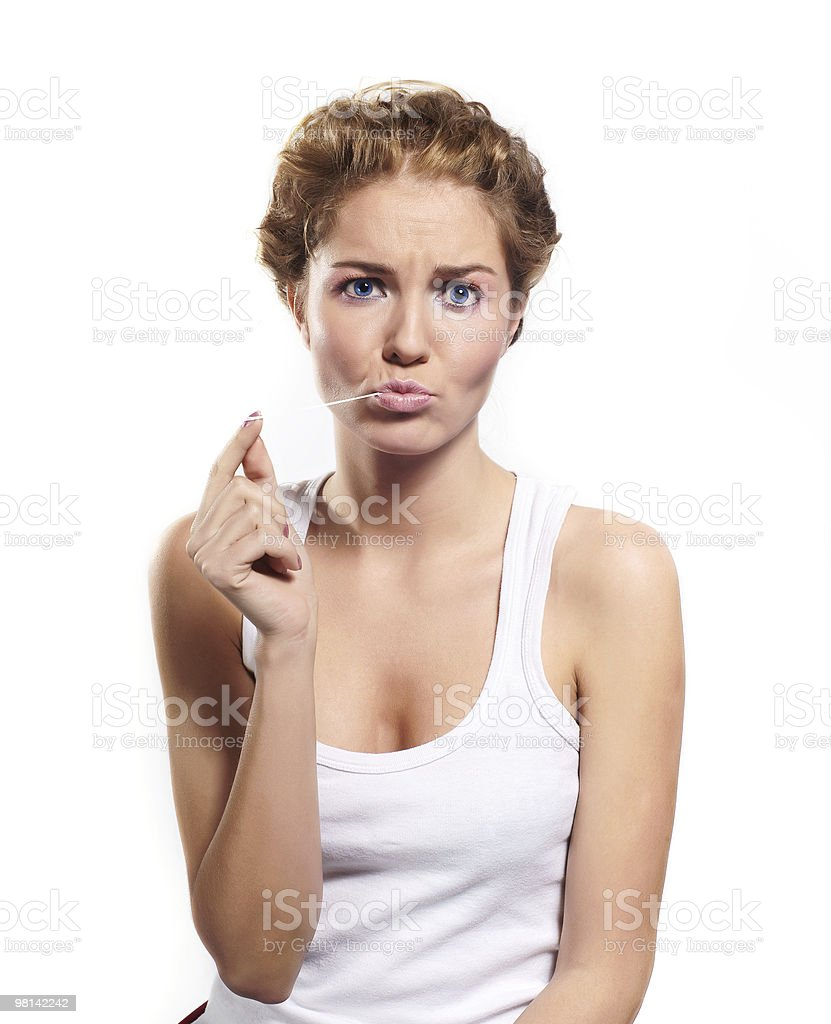 beautiful young girl with gum in your mouth royalty-free stock photo