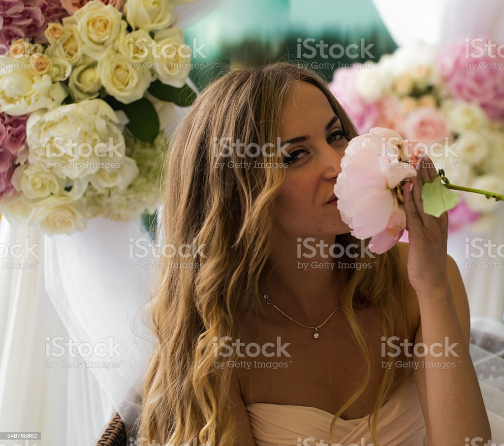 Beautiful young girl with long hair flowers in hand stock photo beautiful young girl with long hair flowers in hand royalty free stock photo izmirmasajfo