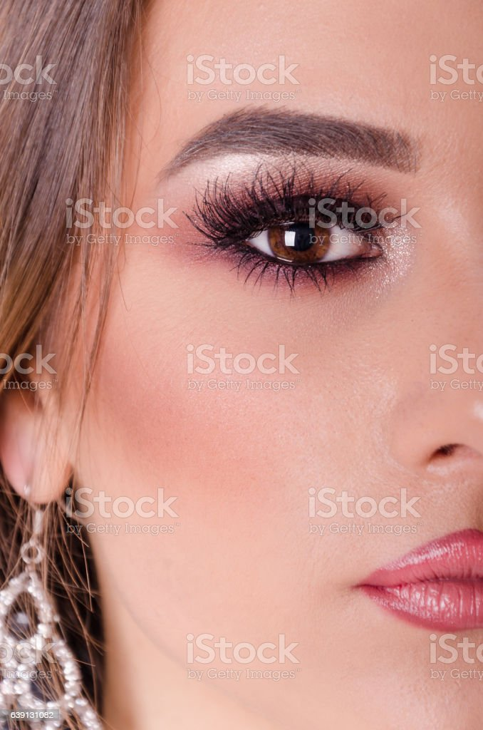 Beautiful young girl with professional makeup posing with half f stock photo