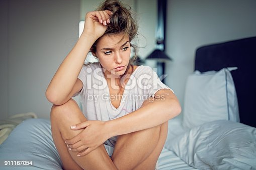 istock Beautiful young girl with relationship difficulties standing sad in the bed 911167054