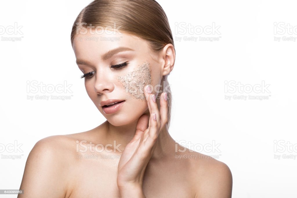 Beautiful young girl with scrub on the skin, French manicure stock photo