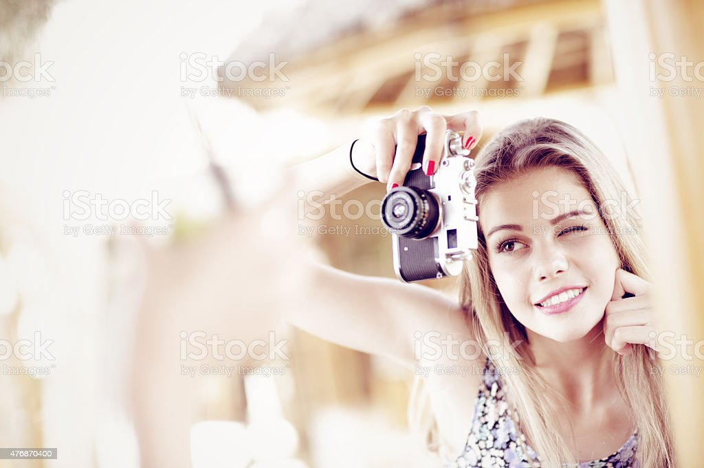beautiful young  girl with vintage camera stock photo