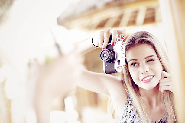 beautiful young  girl with vintage camera - little girls giving head stock photos and pictures