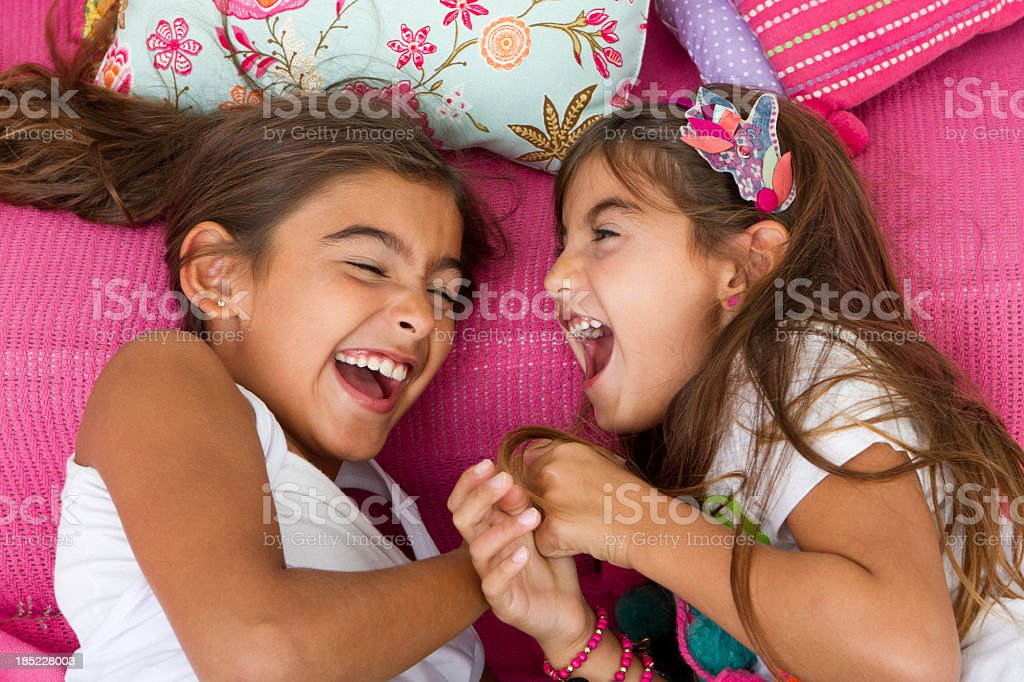 Beautiful young girls laughing together stock photo