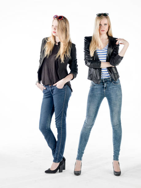 beautiful young girls posing in blue jean and jacket beautiful young fashion girl posing at studio. ladies wear blue jean and jacket skinny pants stock pictures, royalty-free photos & images