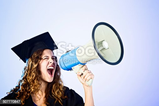 1166716628 istock photo Beautiful young graduate shouting happily into bullhorn 507770847