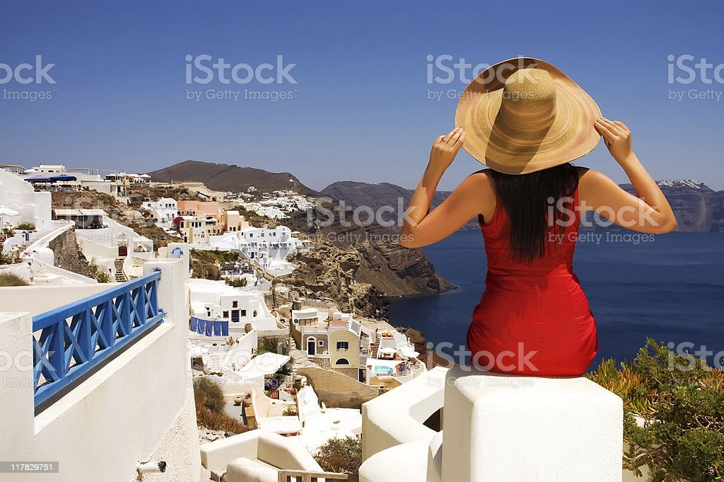 Beautiful young Greek woman on the streets of Oia, Santorini royalty-free stock photo