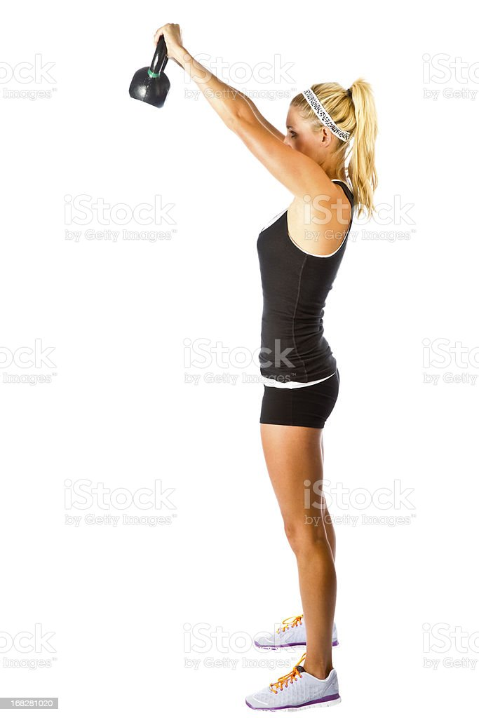 Beautiful Young gym Woman with Kettle Ball royalty-free stock photo