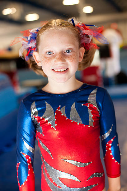 beautiful young gymnast smiling while in leotard - uneven parallel bars stock photos and pictures