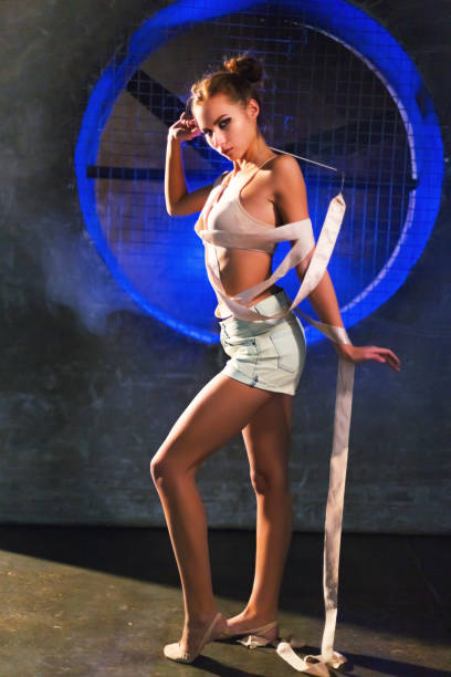 Beautiful young gymnast woman posing wrapped in gymnastics tape stock photo