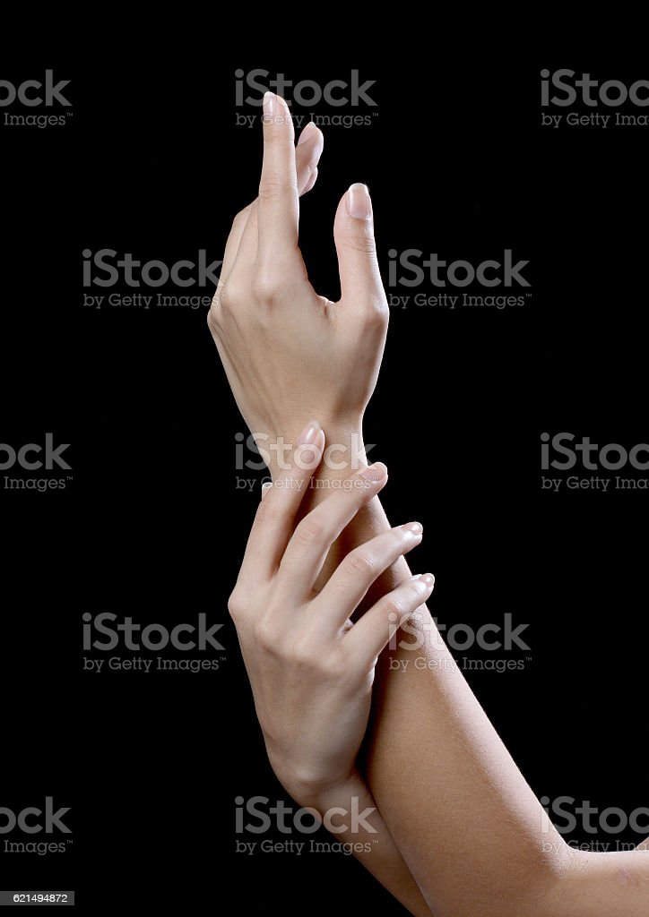 beautiful young hands woman isolated on black background photo libre de droits