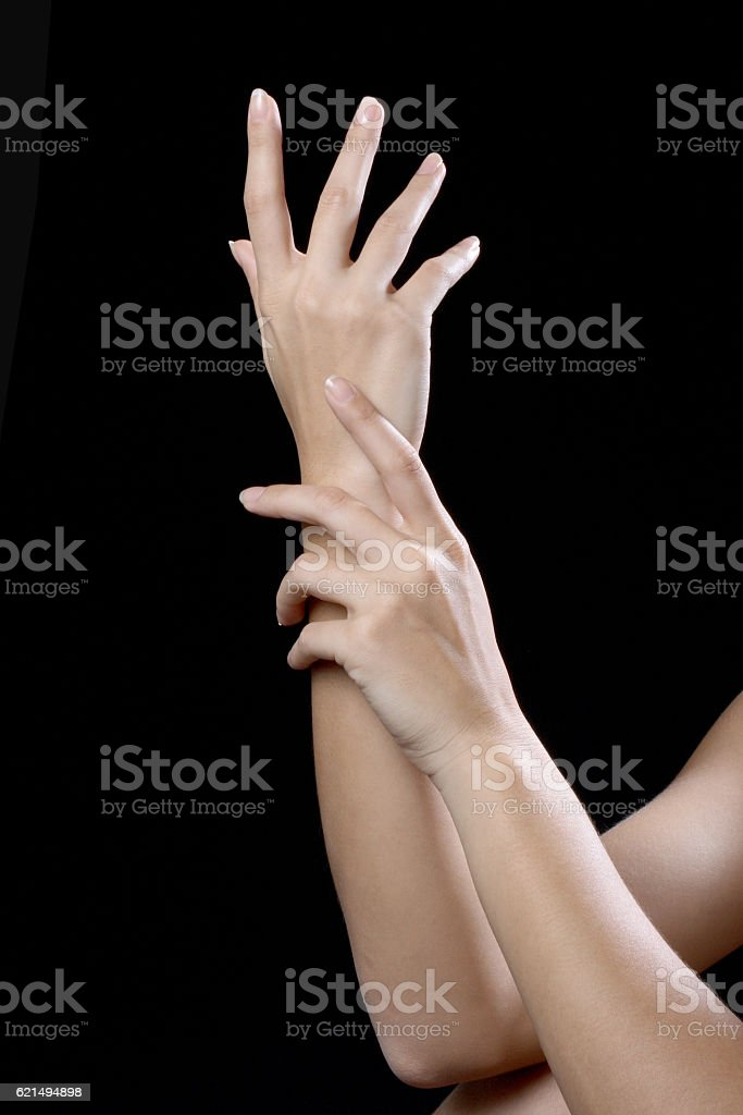 beautiful young hands woman isolated on black background Lizenzfreies stock-foto