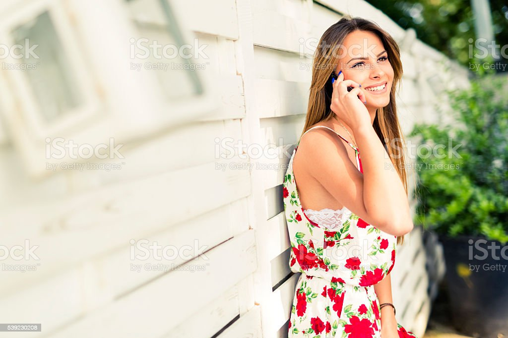 Beautiful young happy woman smiling during a phone call royalty-free stock photo