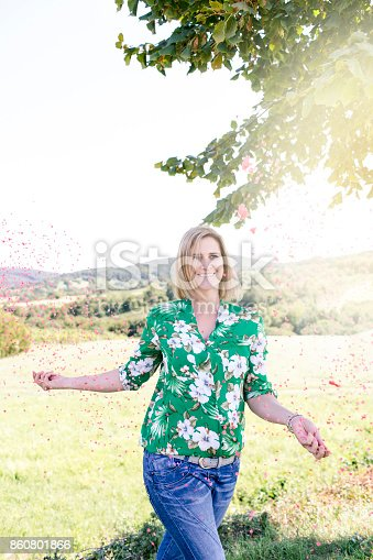 istock beautiful, young, happy woman with confetti 860801866
