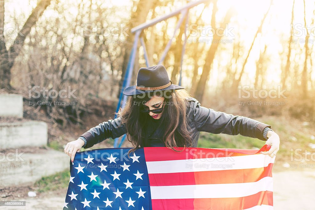 Beautiful Young Hipster Woman with USA Flag stock photo