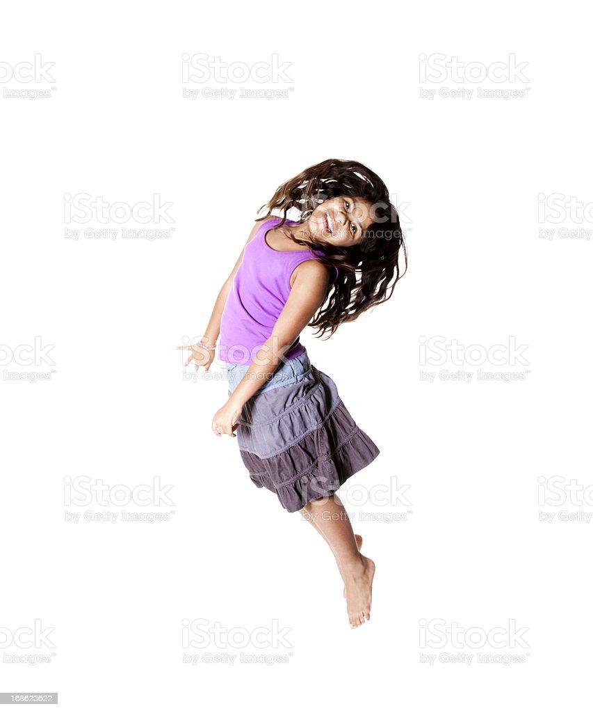 Beautiful Young Hispanic Girl jumping for Joy royalty-free stock photo