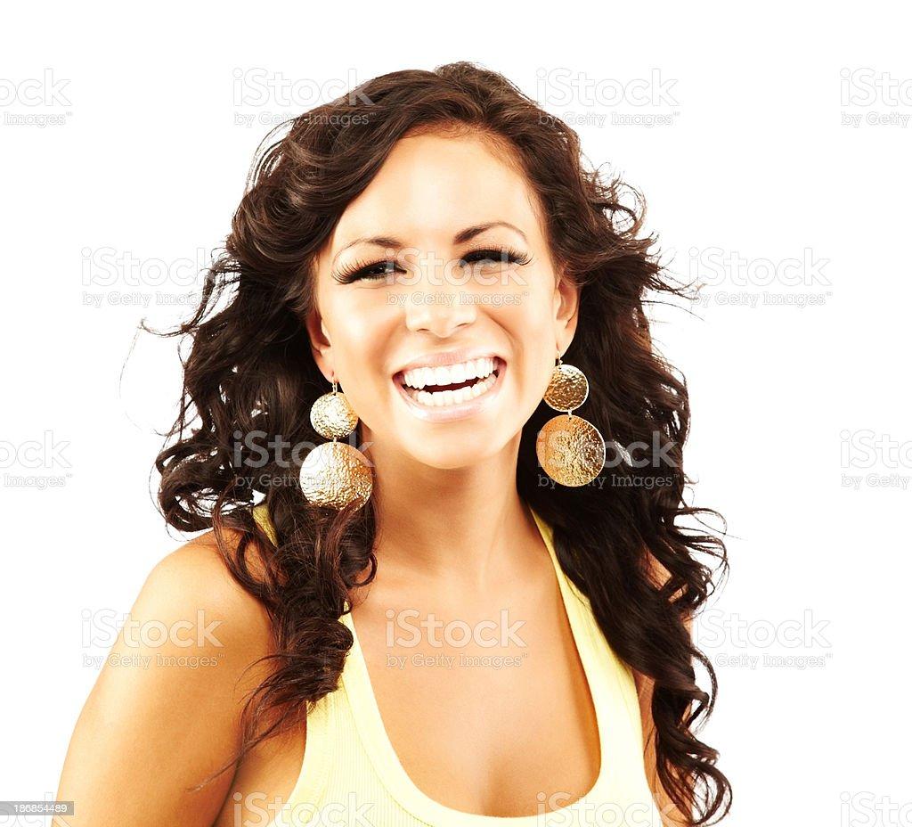 Beautiful young hispanic woman looking at camera laughing royalty-free stock photo