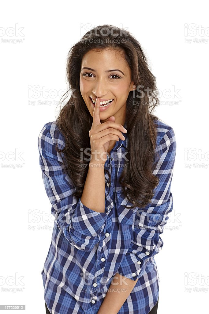 Beautiful Young Indian Girl With Her Finger On Lips Royalty Free Stock Photo