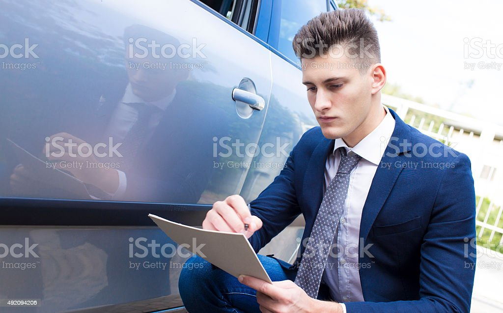 beautiful young insurance agent watching car damaged stock photo