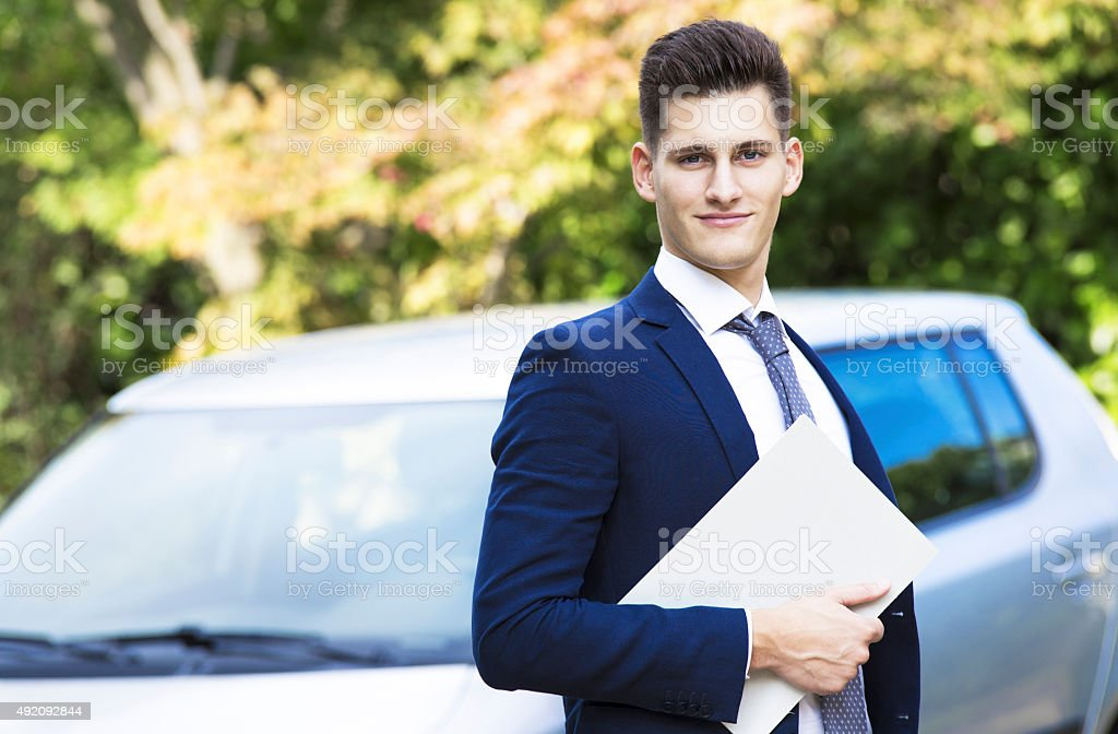 beautiful young insurance agent watching straight in camera stock photo