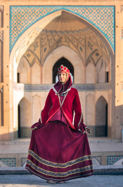 beautiful young iranian lady in a mosque stock photo
