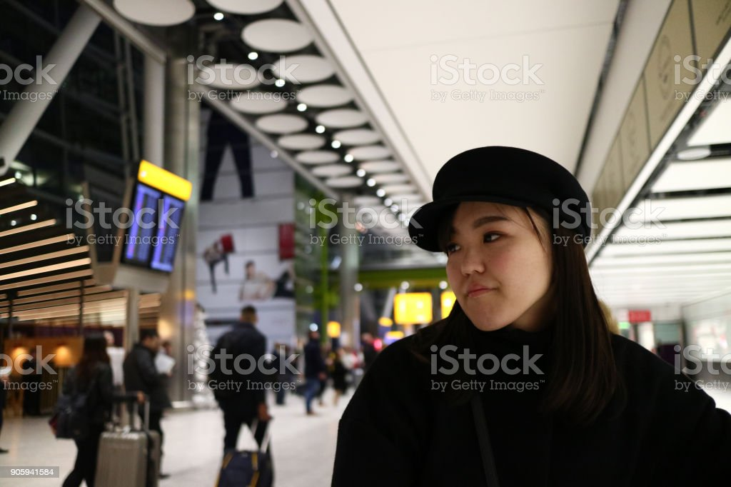 A beautiful young Japanese woman waiting in the airport stock photo