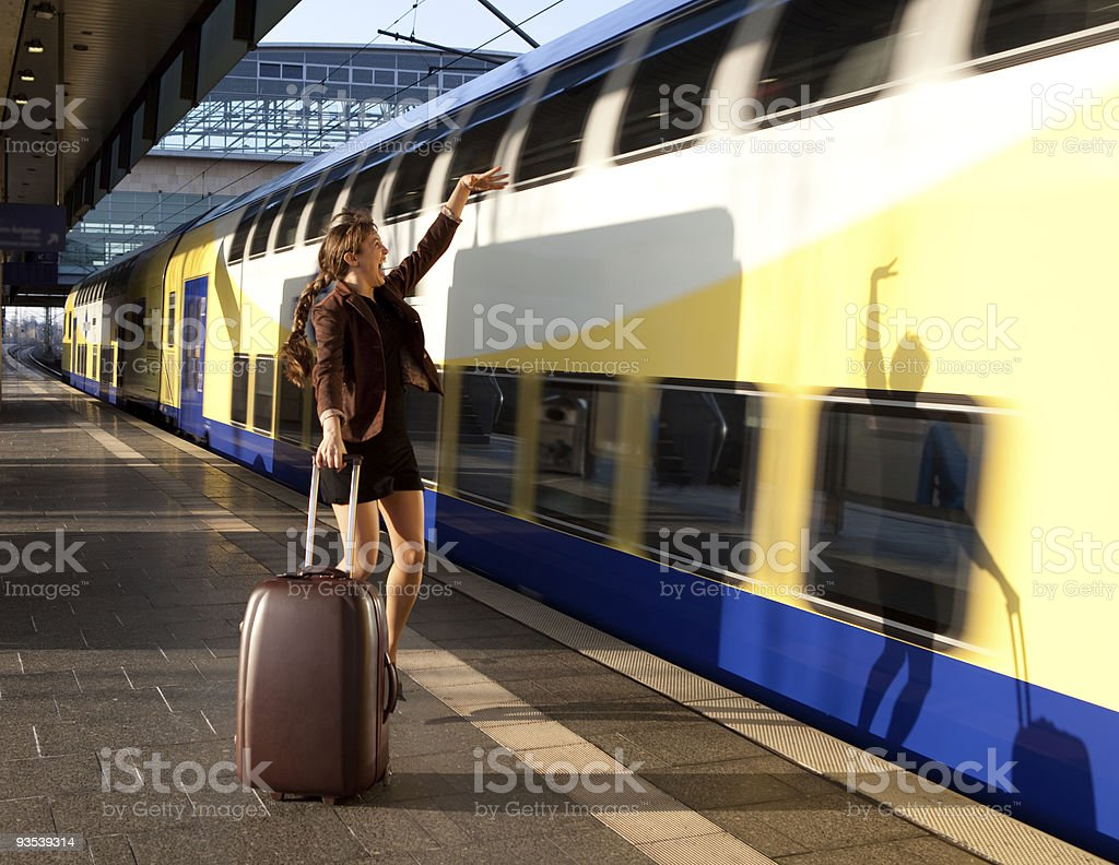 beautiful young lady with luggage stop a train royalty-free stock photo