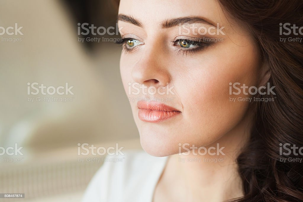 Beautiful young lady with soft make up stock photo