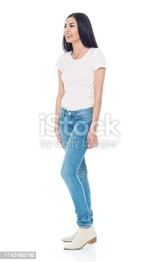 Beautiful young latino female wearing a tshirt and jeans - hands by side