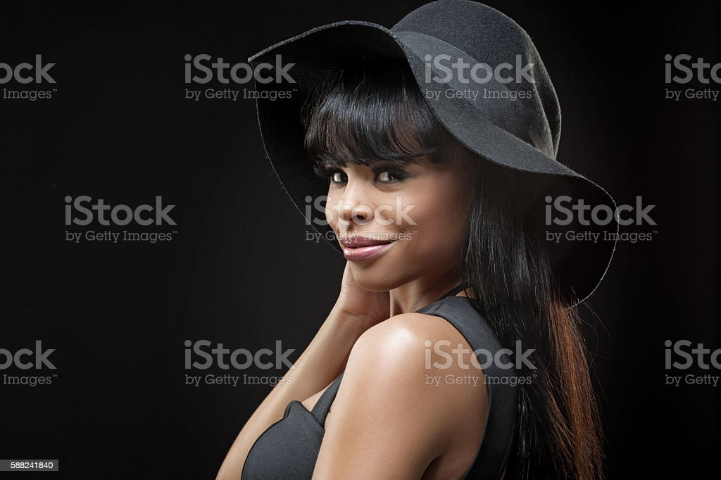 Beautiful young long haired coloured female posing in studio stock photo