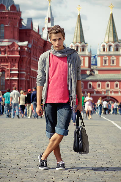 Beautiful young man in the city stock photo