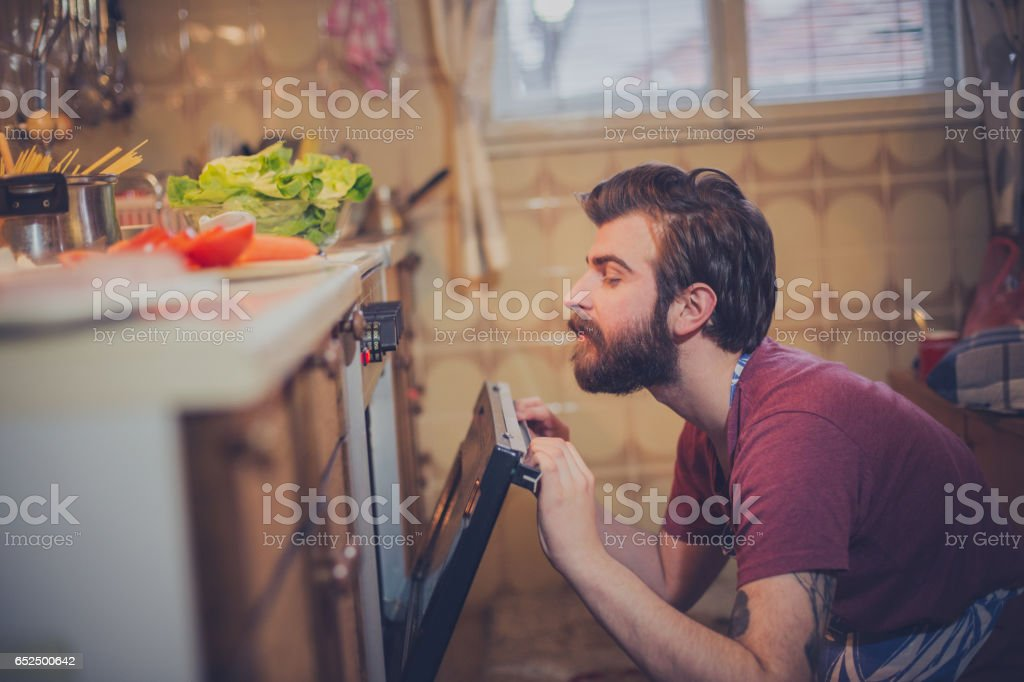 Beautiful young man preparing healthy meal stock photo