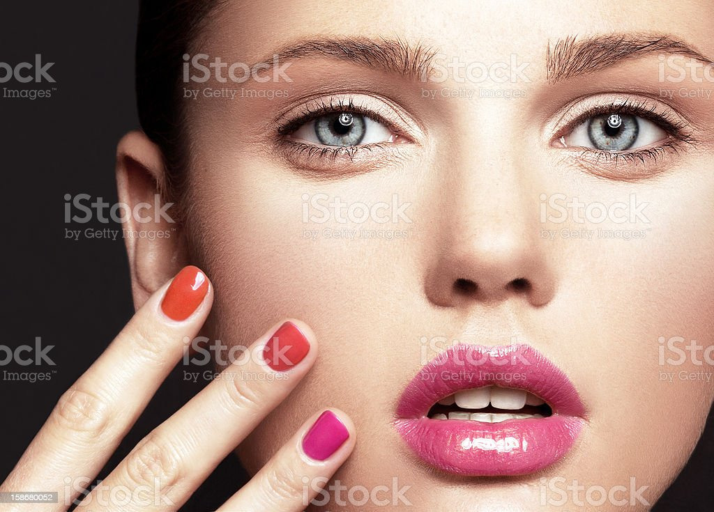 Beautiful young model with bright make-up and manicure stock photo