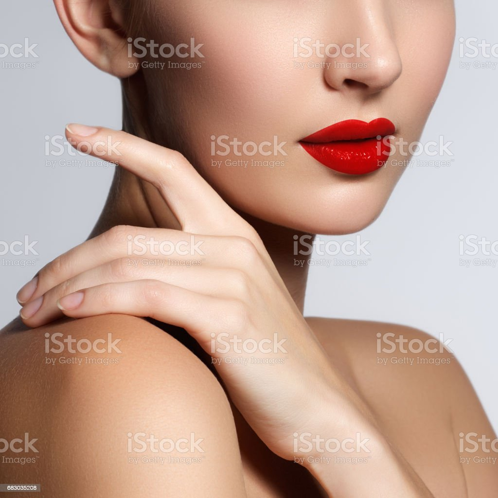 Beautiful young model with red lips and french manicure foto de stock royalty-free