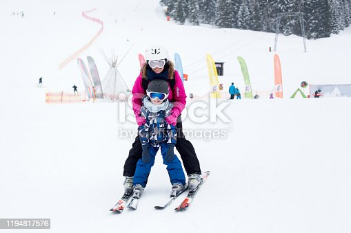 istock Beautiful young mom and her preschool boy, skiing in the mountains 1194817576