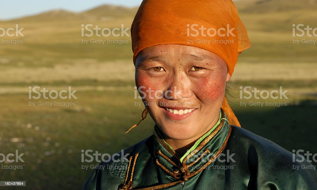 Beautiful young Mongolian lady in the late afternoon sun stock photo