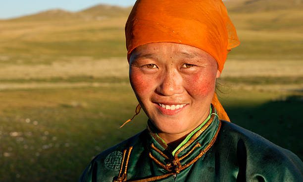 Beautiful young Mongolian lady in the late afternoon sun Beautiful young Mongolian lady in the late afternoon sun mongolian culture stock pictures, royalty-free photos & images