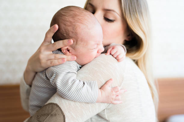 Beautiful young mother holding baby son in her arms picture id638906320?b=1&k=6&m=638906320&s=612x612&w=0&h=jo1d8e14lkekb8hzipnifvzkgiu0nou3ep8wvwwalwg=