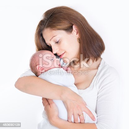 istock Beautiful young mother holding her sweet newborn baby 483690109