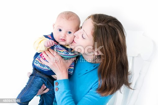 istock Beautiful young mother kissing her little baby boy 485947845
