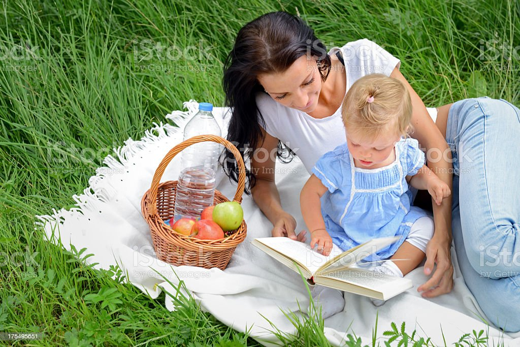 Beautiful young mother with her baby girl outdoors royalty-free stock photo