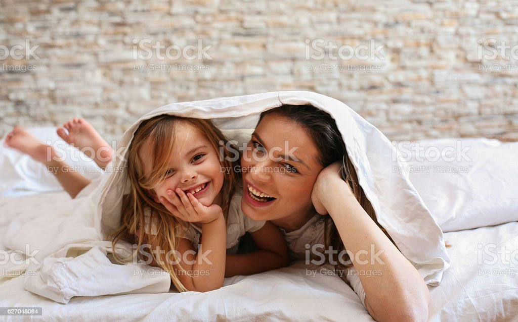 Beautiful young mother with her cute little daughter. stock photo