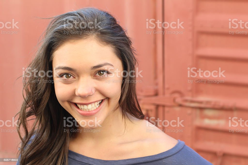 Beautiful young multicultural woman outdoor portrait. stock photo
