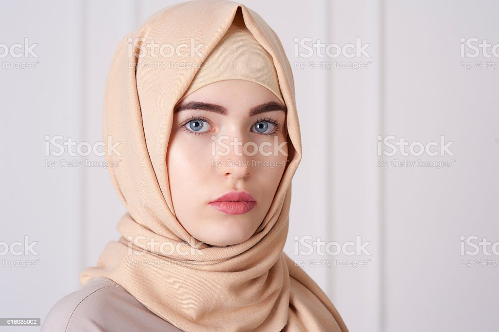 beautiful young Muslim woman wearing a hijab on her head stock photo