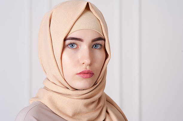 beautiful young muslim woman wearing a hijab on her head - arabic girl stock photos and pictures