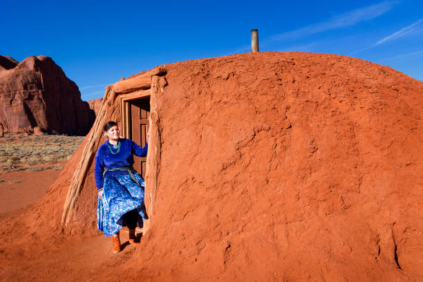 beautiful young navajo woman outside her hogan - native american reservation stock photos and pictures