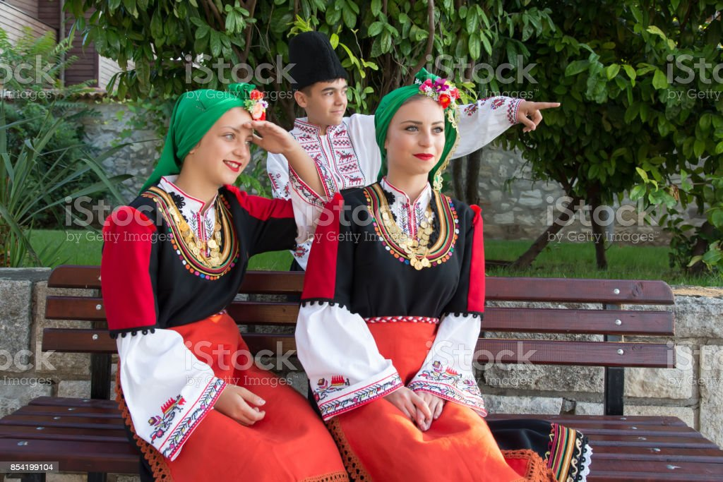 Beautiful young people in national costumes. Concept of identity preservation. stock photo