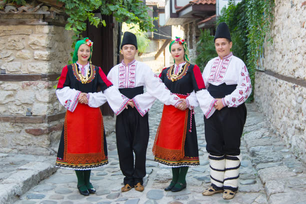 Beautiful young people in national costumes. Concept of identity preservation. Beautiful young people in national costumes. Concept of identity preservation. bulgaria stock pictures, royalty-free photos & images